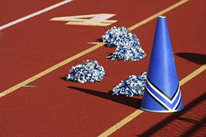 Cheerleader pom poms and megaphone